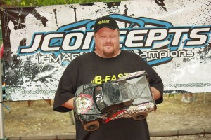 venom gambler, darryn johnson, jconcepts, rcca, radio control, rc car action, photo 2, man, holding car