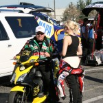 A brief father/daughter moment of quiet between John & Courtney Force before the racing action began.