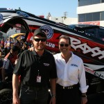 Traxxas CEO Mike Jenkins & Air Age President Louis DeFrancesco pose for a photo before Courtney Force's qualifying run.