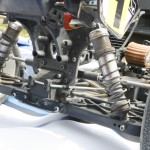 A view from the rear gives us a better look at that extended rear shock tower that allows the arms to be run more flat. You also can get a better feel for just how far apart the rear shocks are on Ty's truggy.
