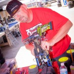 World Champ Dad, Paul King wrenching on Cody's Truggy.