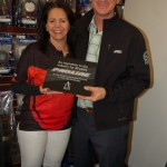 AirAge Media co-owner Yvonne DeFrancesco presents Pro-Line president Todd Mattson with a special plaque.