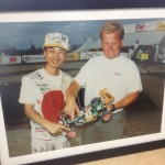This framed photo is of Pro-Line's R&D Director, Tim Clark, with Masami Hirosaka after winning the 1993 IFMAR 4WD Off-Road World Championships in Basildon, England.