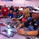 Traxxas always has tons of star power in their booth. Courtney and John Force held it down with Robert Hight for Traxxas' NHRA team.