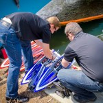 The Traxxas crew prepping their Spartan boats for a demo.
