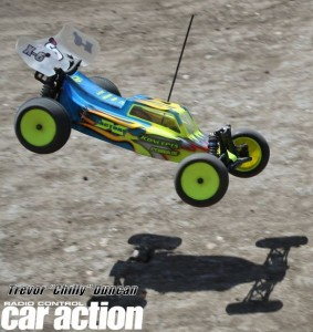 X Factory's Paul Sinclair landing a jump in his carbon fiber X - 6 Cubed mid motor mod 2WD buggy.