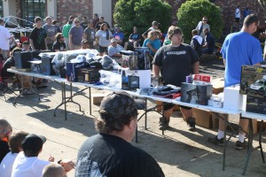 The race team sets up the door prizes.