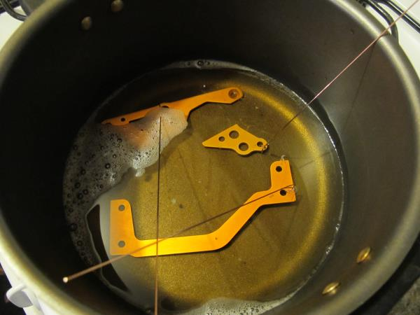 Pour enough of the Greased lightning solution into an old pan to completely submerge all components. Wrap a wire or zip-tie around the components to lower and remove them from the solution.