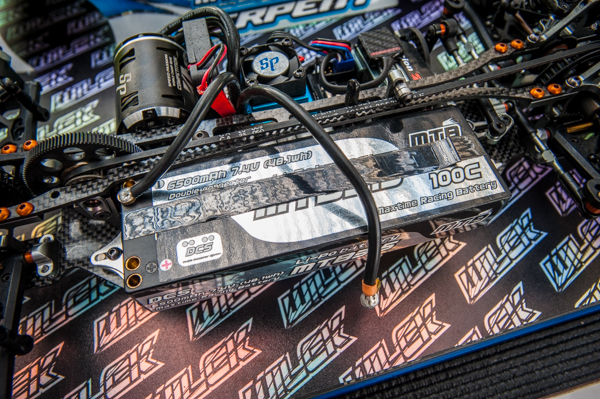 An Maxtime Racing 6500mah 100C LiPo battery powers his car and gives it smooth and consistent power while balancing the car's weight bias.