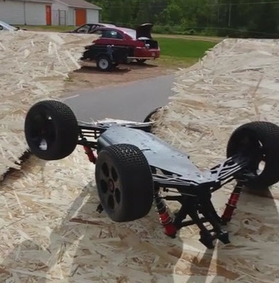 Distance Record Jump Attempt: Car Shatters Ramp On Re-Entry [VIDEO]