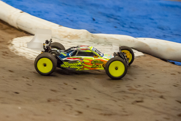 Travis Amezcua's Team Durango DEX210 V3 on the track and running tight lines.