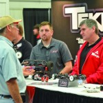 Explaining new technology and performance at the Tekin booth.