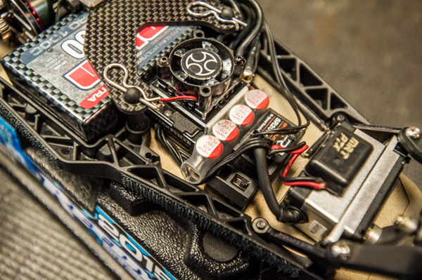 He uses a big capacitor by HobbyWing to help with punch in stock and it pairs nicely with his Orion speed control. The capacitor also helps with braking since short stack motors tend to have lass natural braking characteristics.
