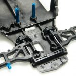 The front arms are fastened to the chassis with similar plastic hinge pin holders as the rear suspension.