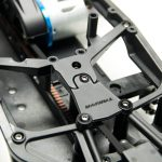 The center chassis brace adds a lot of stiffness to the chassis when installed and it incorporates an antenna mount.