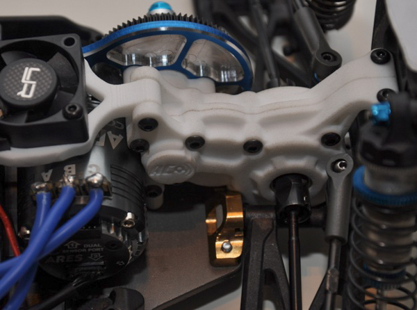 "AC rc gear uses a 3D printed case and ""waterfall"" for use with the Team Associated B5M."