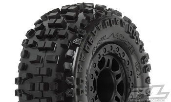 "Pro-Line Badlands SC 2.2""/3.0"" Tires Mounted On Black Split Six Wheels"