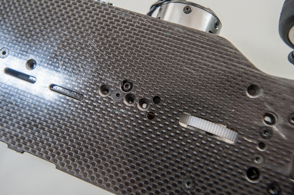 The motor mount uses various spots on the chassis to adjust flex depending on how it is screwed in.