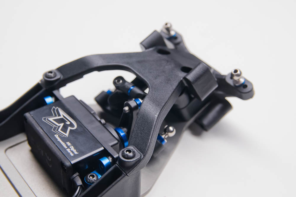 The top plate finishes the front end of the chassis attaching to the side rails and ball stud mount. Incorporated into the top plate is the front shock tower mount.