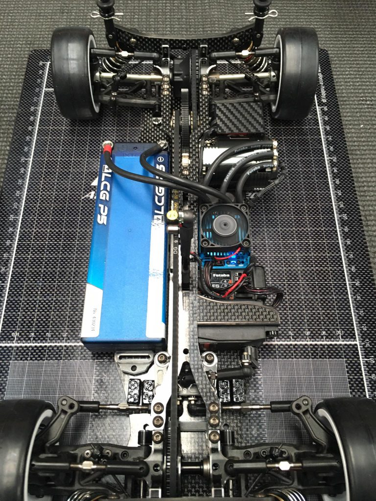 Hara always keeps his cars immaculate and in perfect condition. Although not taped in yet, you can see him using an LRP full sized LiPo pack with 4mm bullet connectors.