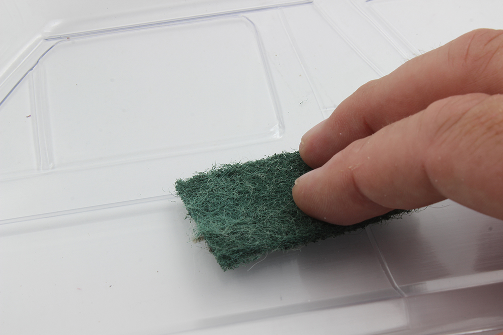 A Scotch-Brite pad is all you need to scuff up the inside of the body. is will give the paint something to grab onto.