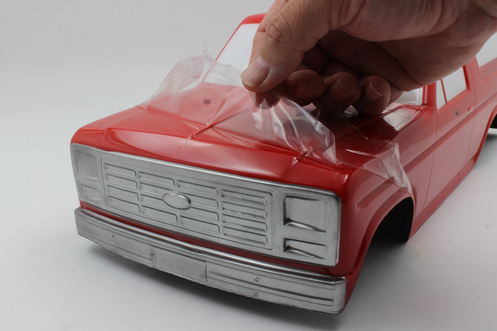 Remove the overspray film from the main part of the body and take your time. Make sure that you don't remove the film from areas such as the bumpers and windows