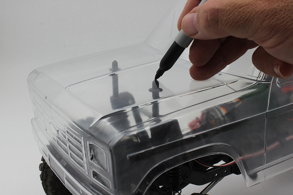 Mounting the body before painting is easy to do and, in this case, will prevent damage of the painting done on the outside.