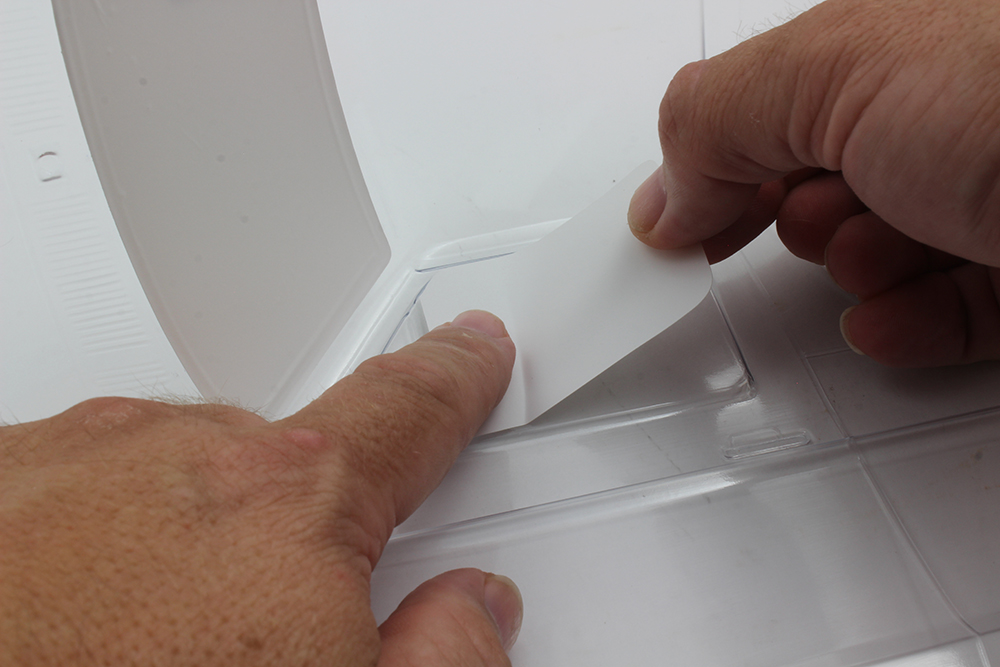 When applying the window masks, place a corner down, line up an edge of the mask with the window, and press down with your finger.