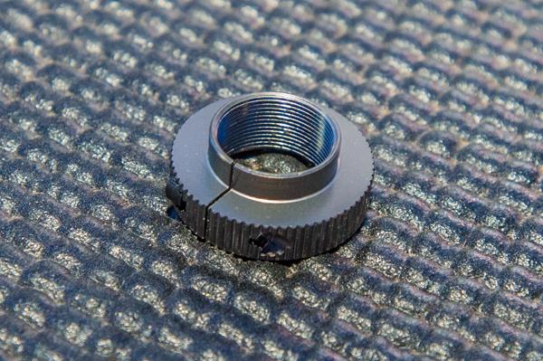 A close up of the new aluminum servo saver piece.