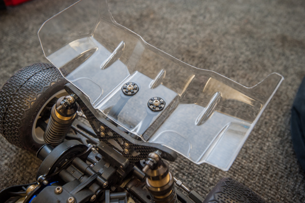Jason drilled out the plastic wing mounts so he can use milled aluminum wing buttons and titanium screws from Schelle Racing Innovations. He feels this helps to clean up the wing area and allows more precise tuning of the wing.
