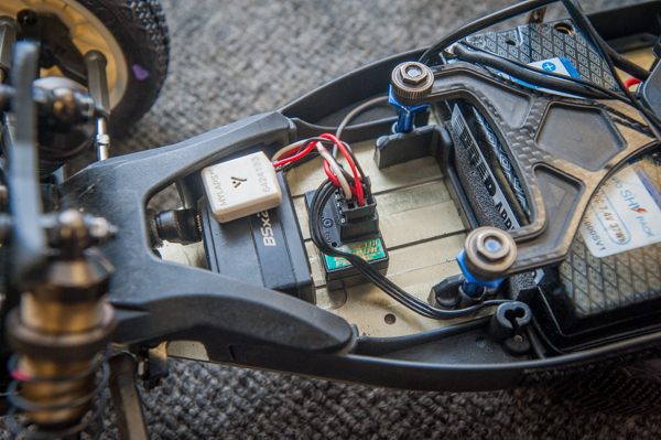 """KO Propo BSX2 shorty, """"response version"""" servo with shortened wires provides the speed and torque necessary for racing and frees up some space on the chassis. This is paired up with Schelle Racing Innovations' aluminum steering rack for precise response."""