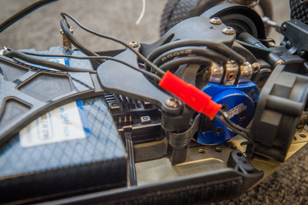 Jason is running the new-to-be-released, unnamed HobbyWing brushless speed control that is a smaller version of the current XR10 Pro, with smaller footprint and lighter weight, strategically placed behind the battery. This position helps shorten the wires, lowering the overall weight of the buggy. He was quick to point out that wires are often overlooked as a source of unnecessary weight while the speed control unit stays in a more rearward weight bias allowing him to move the battery further forward.