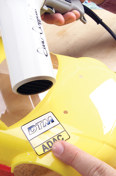 Use a hair dryer to help make a sticker more flexible.