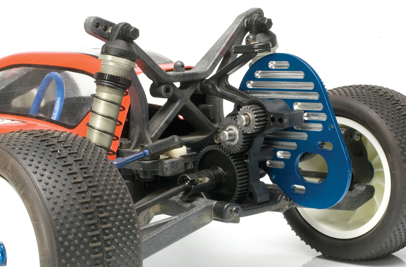 This Associated B4's transmission has been opened to reveal its internal gears.