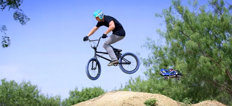 Traxxas Slash 4X4 VS. BMX In A Freestyle Duel